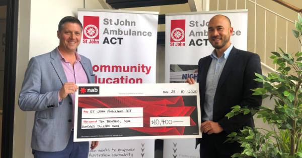 H1 consultant, Alan Larby, presenting a donation cheque to St John Ambulance CEO, Adrian Watts