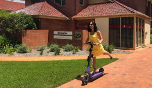 Tammy Tong riding an e-scooter
