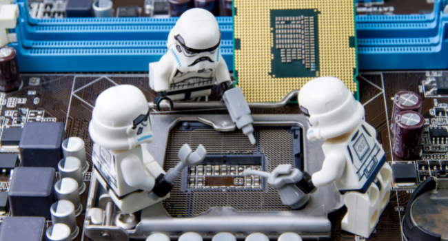 Stormtroopers fixing a computer