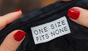 One size fits none printed on a clothing tag